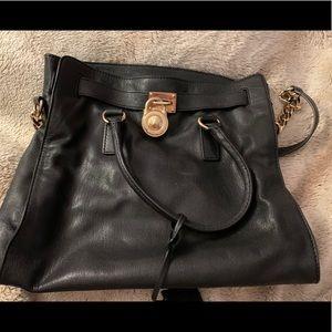 Michael Kora authentic gold and black purse